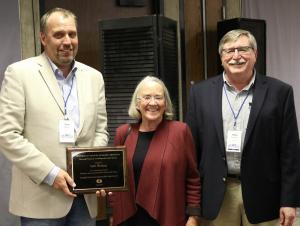 Watkins accepts award