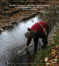 Woman taking water sample, cover photo, Story County Water Monitoring Report 2021-2030