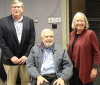 Paul Johnson, seated, center, with LCSA Director Mark Rasmussen and Elaine Spencer.