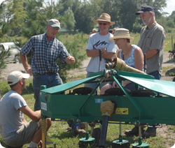 Group of people learning about farm equipment